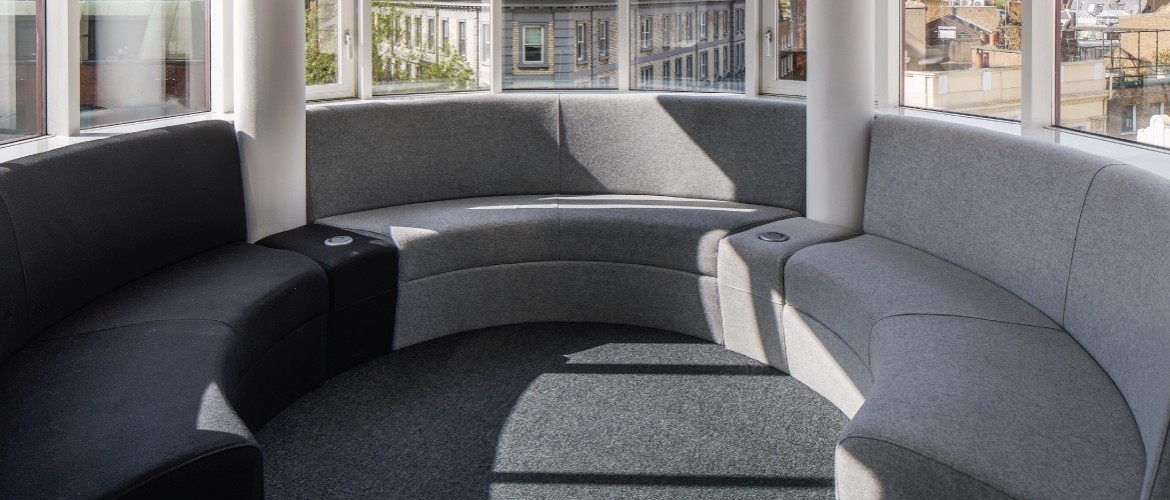 Bespoke seating with power poles for office refurbishment