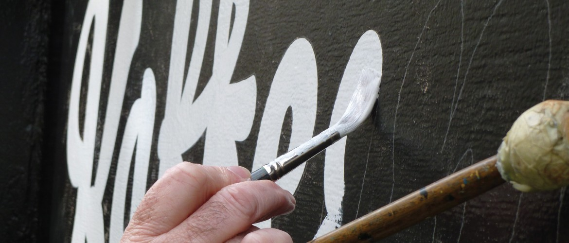 Hand painted traditional sign writing for Kaffiene London shop front
