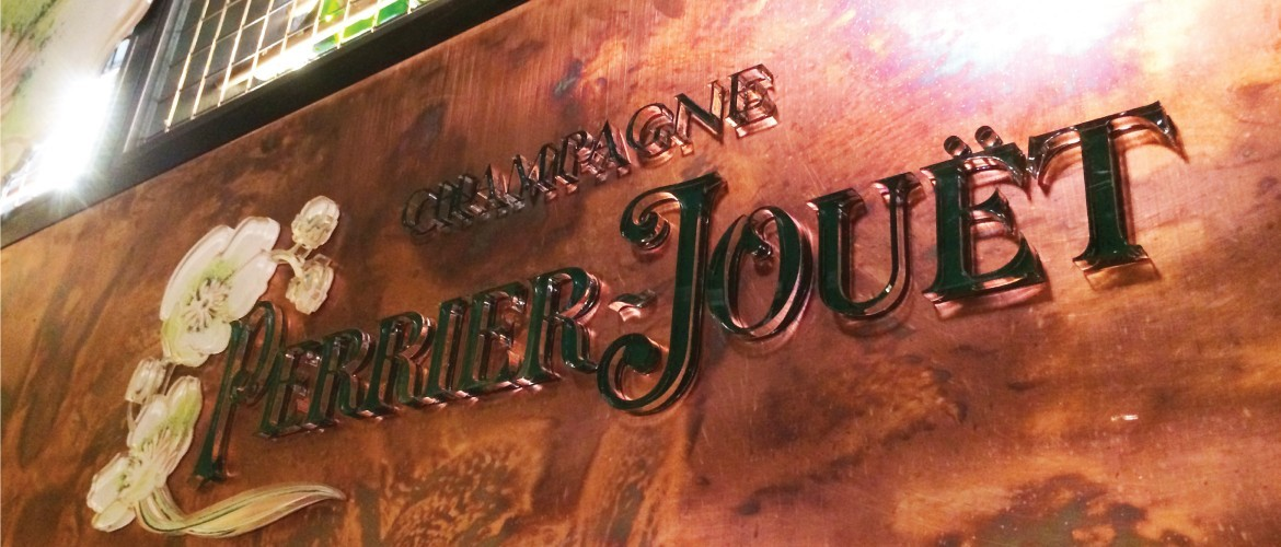Laser cut acrylic and copper interior sign for Perrier Jouet