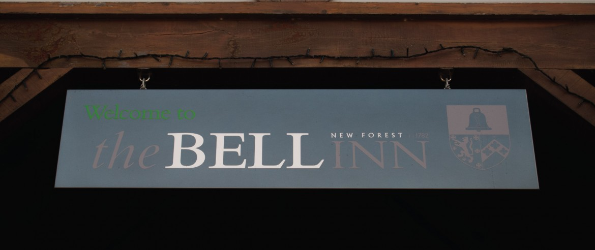 Exterior hanging swing sign with cut vinyl graphics for The Bell Inn