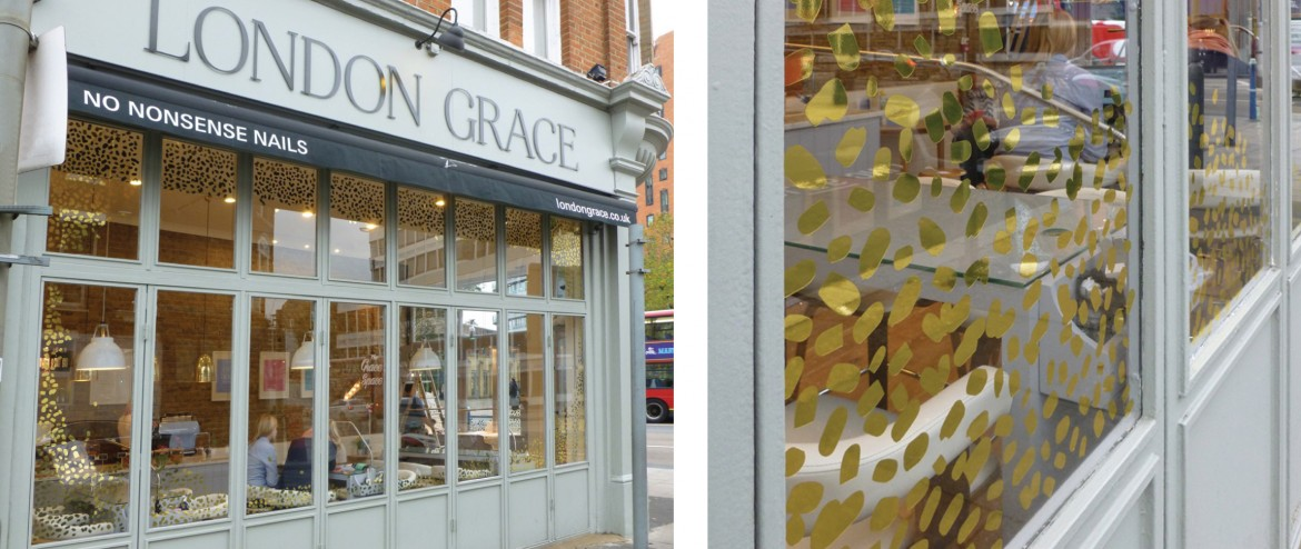 External view of double sided cut gold foil window graphics.