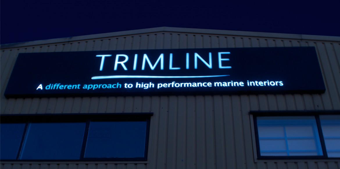 Night shot of exterior illuminated sign, LED back lit with fret cut push through acrylic