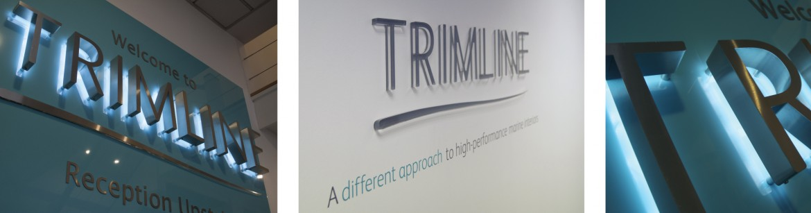 Interior signage for Trimline Ltd, LED back lit stainless steel letters and laser cut acrylic letters