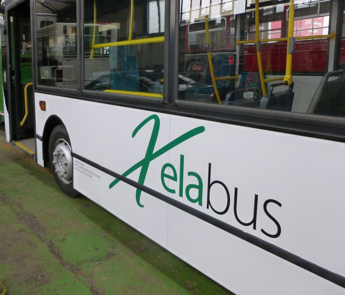 Cut vinyl applied to side and front of bus for Xelabus