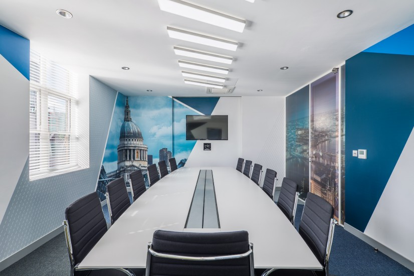 Completed meeting room with printed wall paper, window film and bespoke lighting