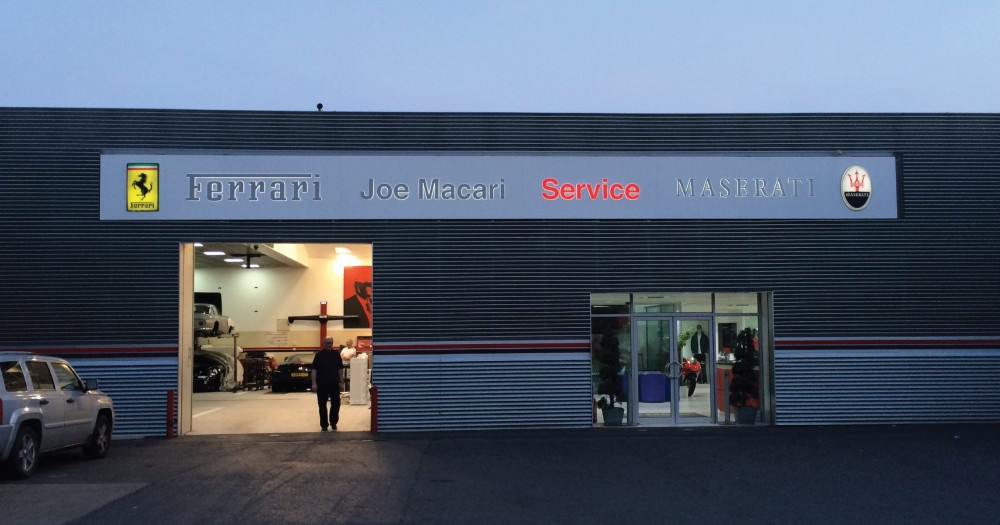Joe Macari Service centre exterior illuminated sign with Ferrari and Maserati logos