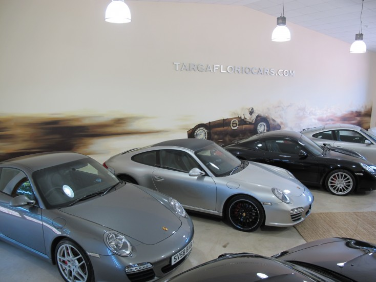 Hand painted interior mural of Porsche with laser cut aluminium signage overlaid.
