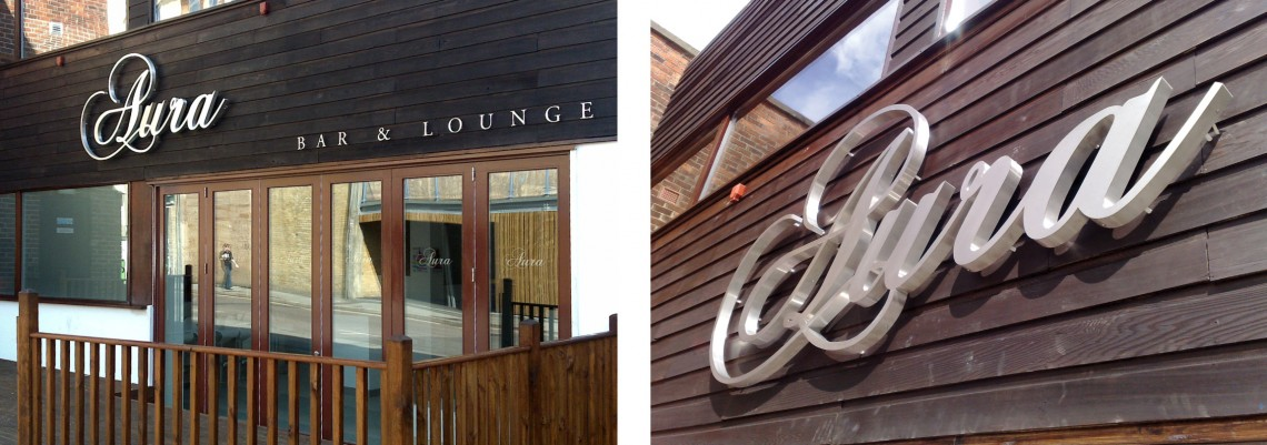 Halo lit brushed stainless steel exterior sign