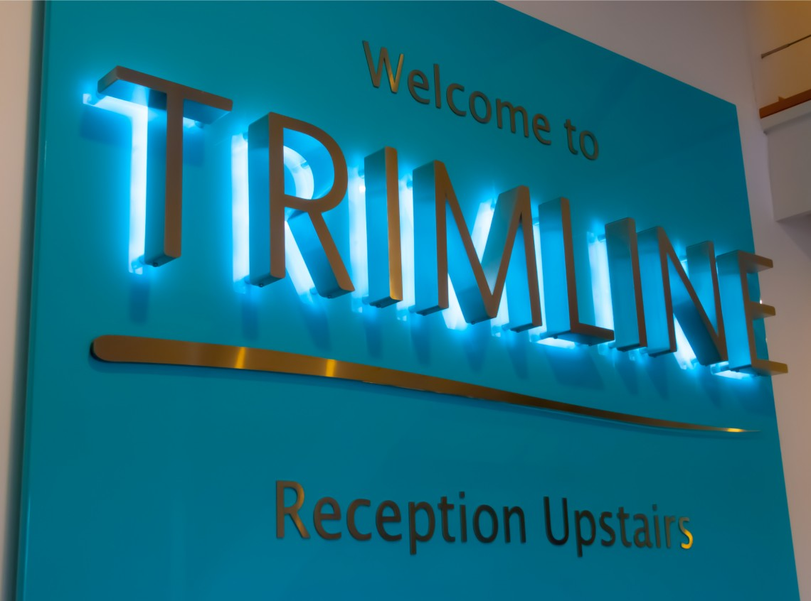 Interior stainless steel LED back lit sign for Trimline